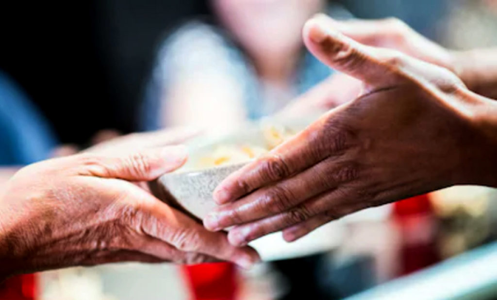 giving food to someone in need